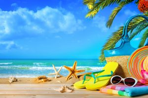 Straw hat and sunglasses on beach. Summer Holidays concept